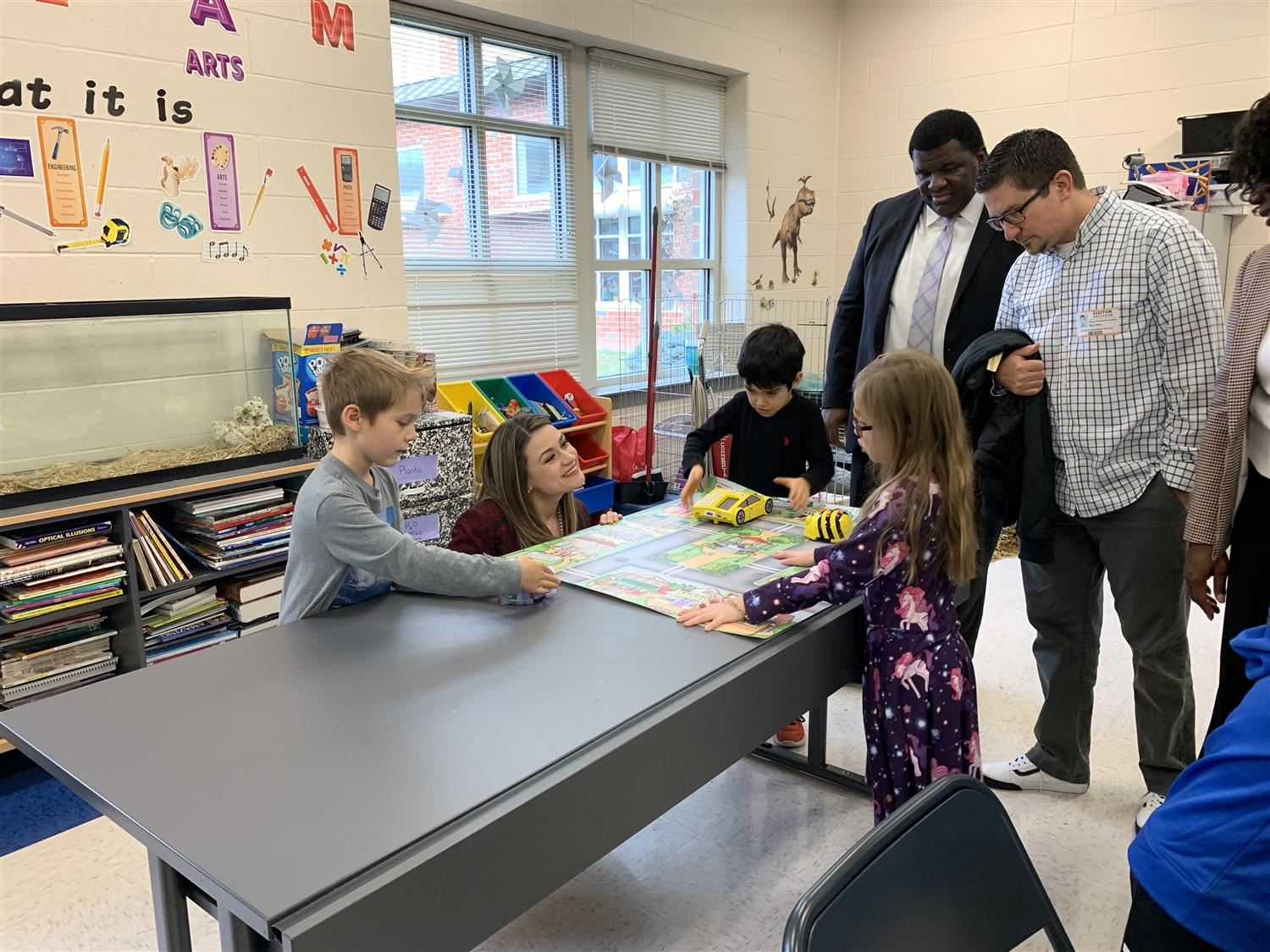 students and adults explore Bee-Bots