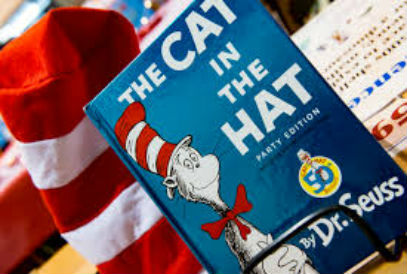The Cat in the Hat book and a red and white striped tall hat