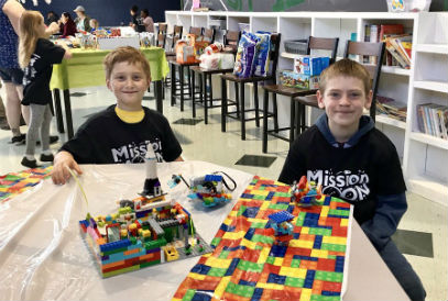 Students displaying their Lego creation at the Lego League Expo
