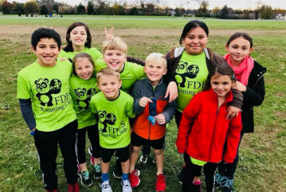 Students in green FDES Running Club T-shirts