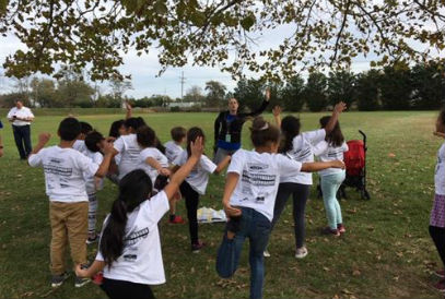 Students stretching before the Fun Run