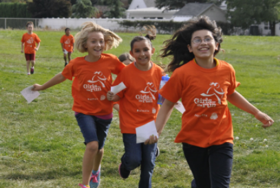 Girls on the Run/girls running in orange t-shirts