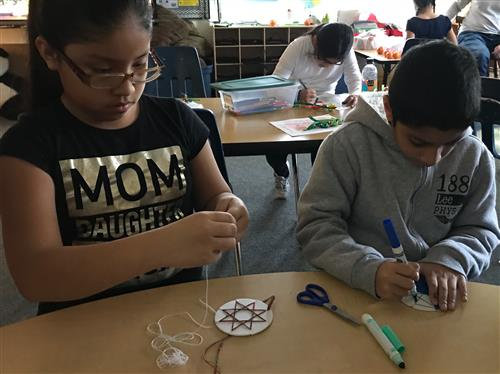students making string art ornaments