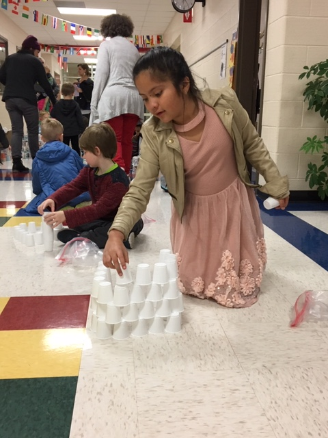 student stacking cups to make an igloo
