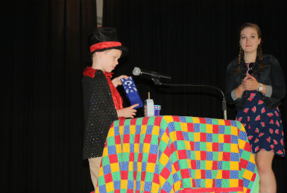 Student performing a magic act