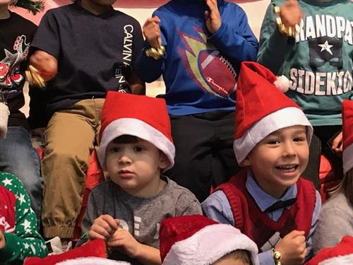 PreK students wearing Santa hats