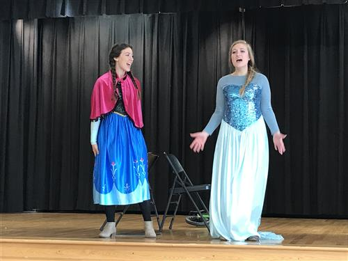 teachers dressed as Anna and Elsa