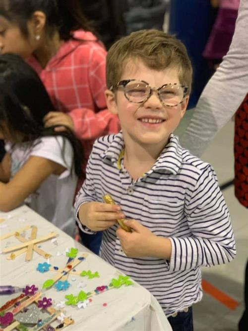 student working at the craft table