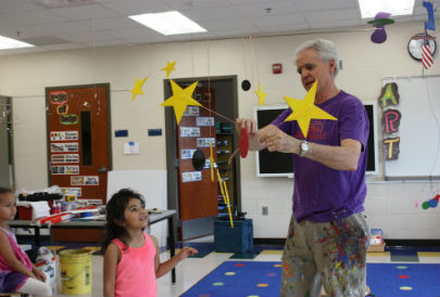Kevin Reese showing students how to balance a mobile.