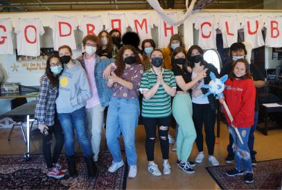 image of boy with megaphone on blue blocks spelling out NEWS