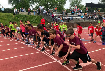 students lined up at the start line during the elementary track meet