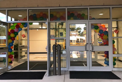 entryway doors decorated with an archway of balloons