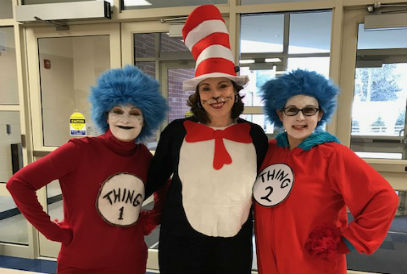 teachers dressed at The Cat in the Hat, Thing 1, and Thing 2