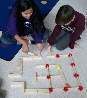 students building a maze with wooden planks
