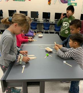 students building with Popsicle sticks